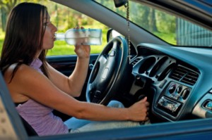 Woman drinking alcohol while driving: LawteryX Traffic, DUI/DWI Blog