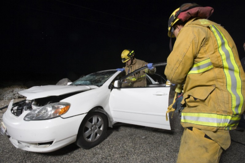 firefighters at car accident scene