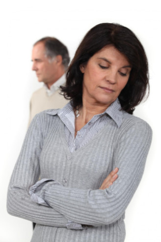 Upset woman with partner behind: Lawtery X Divorce/Family Law Blog