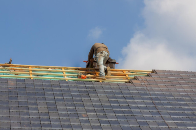 Worker conducting work on roof