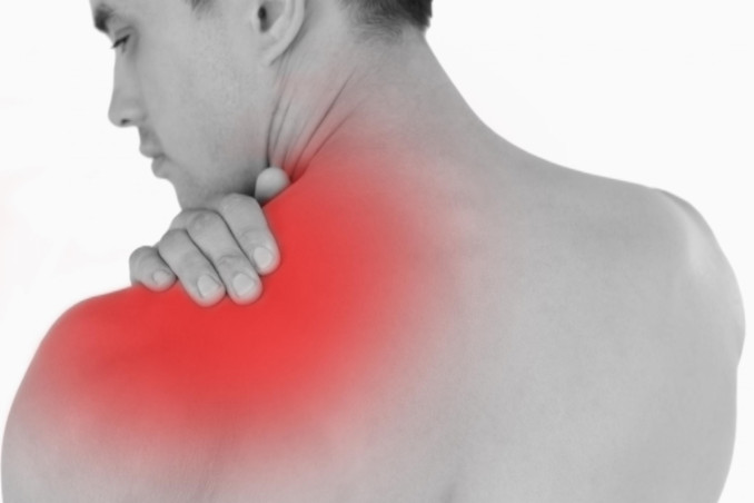 Man holding shoulder in pain: LawteryX Workers' Compensation and Employment Law Blog