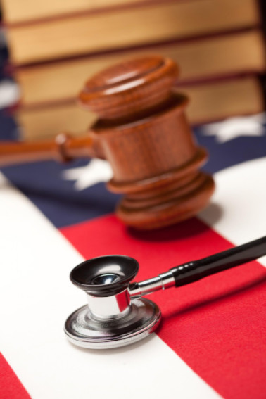Gavel and stethoscope on American flag: LawteryX Defective Drugs and Medical Malpractice Blog