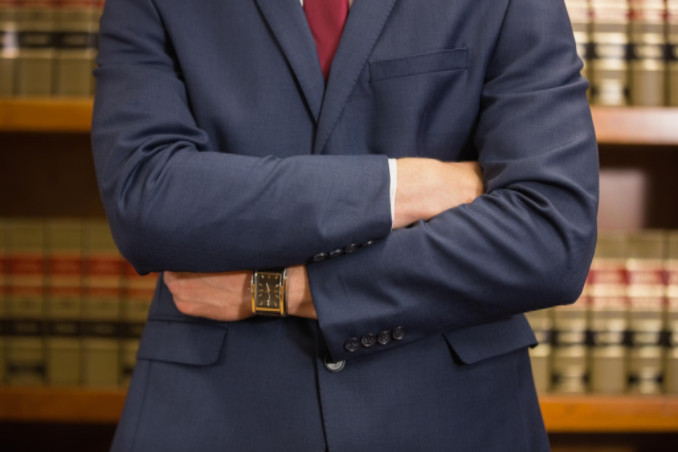 Attorney in front of books: LawteryX Personal Injury & Accidents Blog