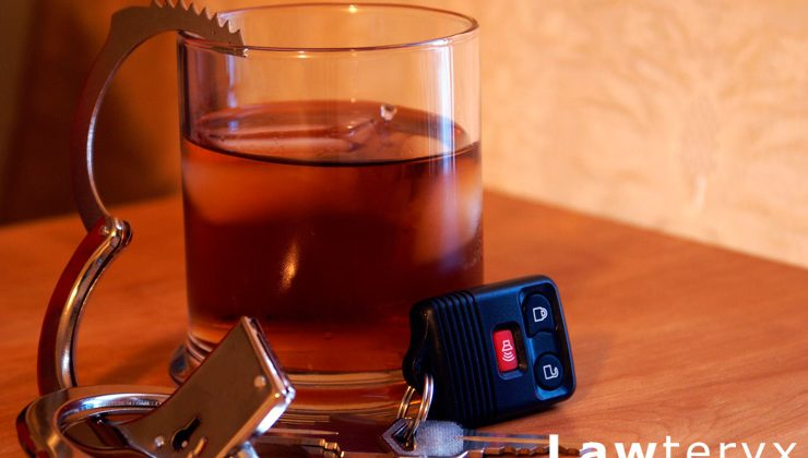 alcoholic drink sitting next to car keys and handcuffs on table