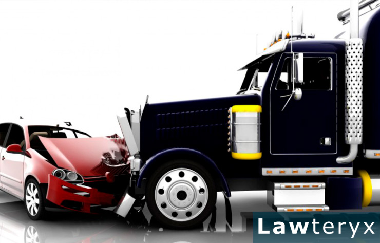 A truck hitting a car and resulting in an accident