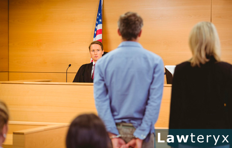 man standing in courtroom to take a plea deal