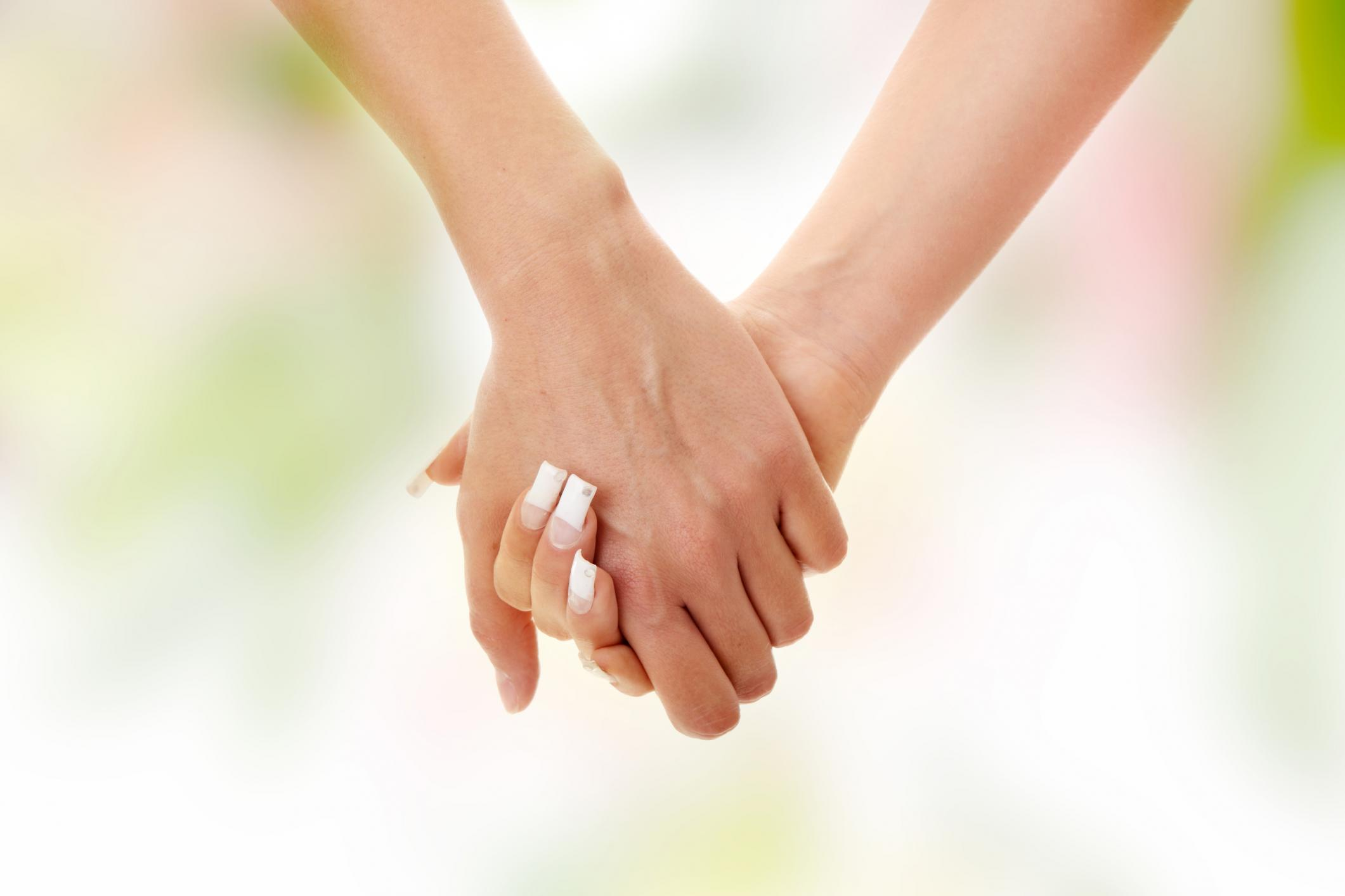close-up-of-lesbian-couple-holding-hands